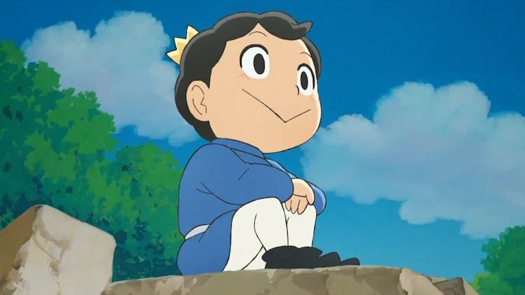 Sentado sobre una muralla de piedra, el príncipe Bojji sueña con ser un gran rey algún día en una escena del próximo anime de televisión Ousama Ranking.