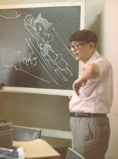 Tezuka giving his speech