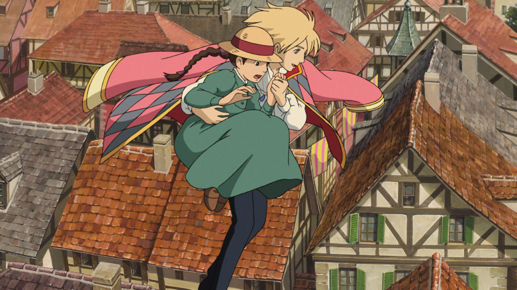 Howl and Sophie soar above the city streets in a scene from the Howl's Moving Castle theatrical anime film.