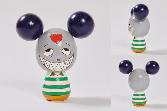 """A promotional image depicting the Love Machine (as """"Impostor Kenji"""") kokeshi dolls sold at the Summer Wars pop-up store."""