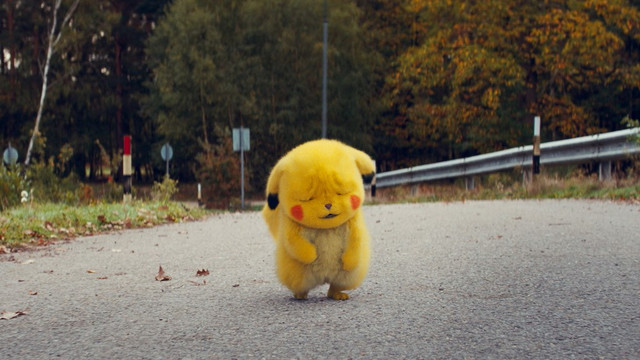 Detective Pikachu trudges home with a sad expression on his face in a scene from the 2019 Detective Pikachu live-action film.