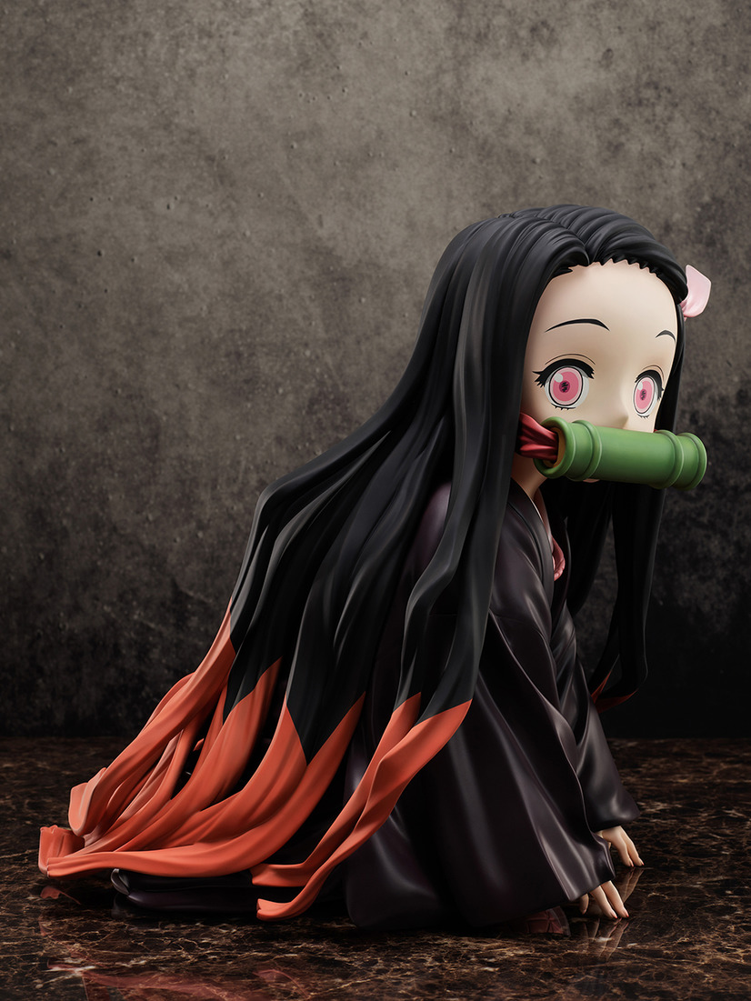 "A promotional image of the ""Demon Slayer: Kimetsu no Yaiba Boxed Nezuko Big Size Figure"" from FuRyu Corporation, depicting a medium profile shot of Nezuko."