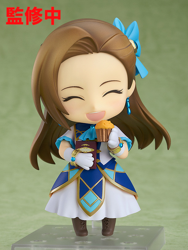 A promotional image of the Nendoroid Catarina Claes toy from Good Smile Company, emphasizing the smiling face and the muffin and romance novel accessories of the heroine of My Next Life as a Villainess: All Routes Lead to Doom!.