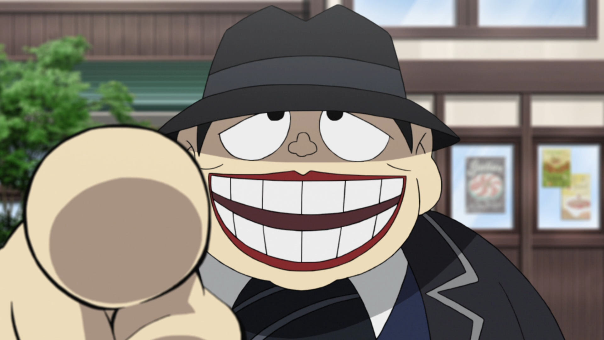 Moguro Fukuzo points an accusatory finger and grins in a scene from the 2017 The Laughing Salesman TV anime.