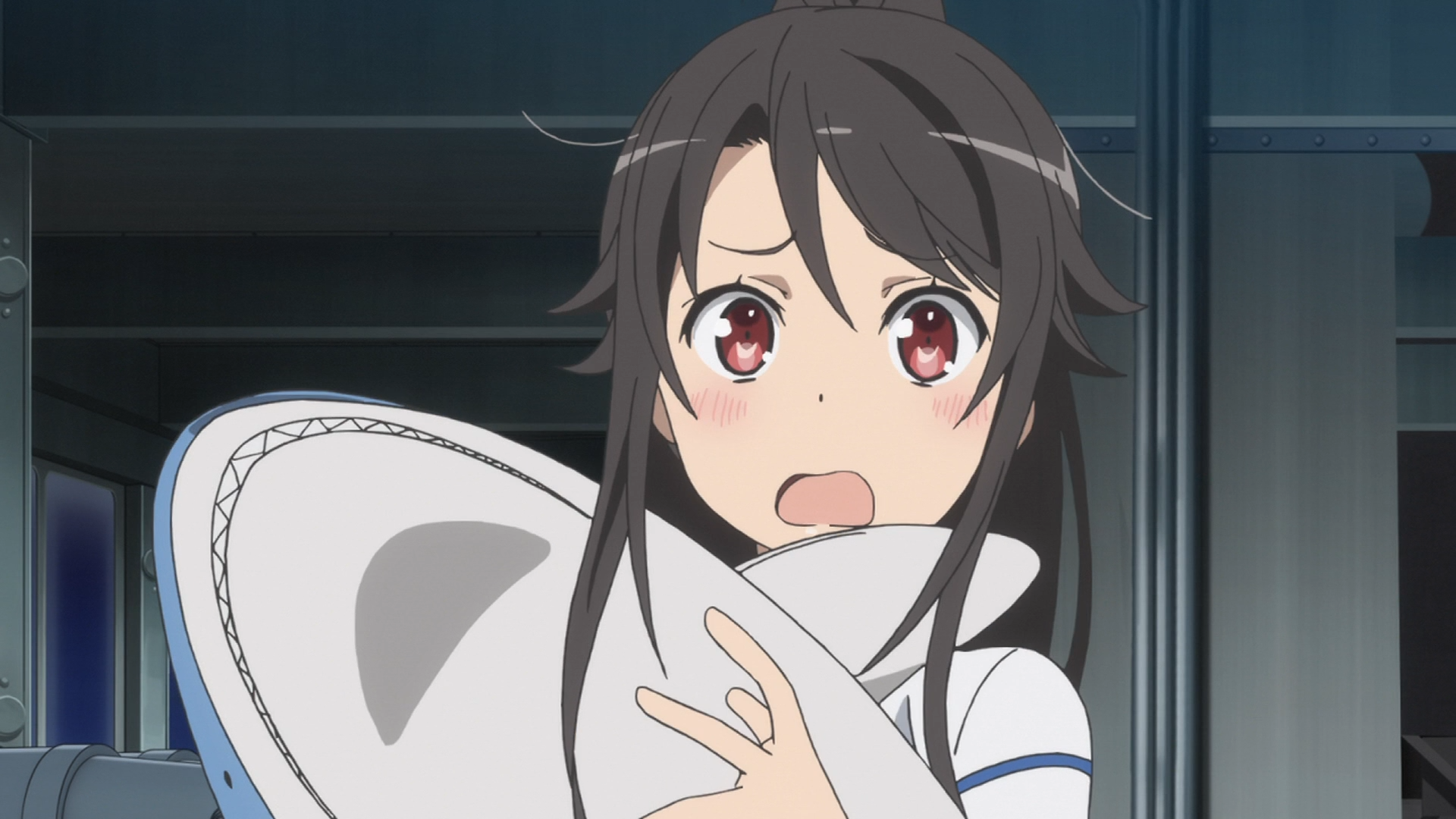 Having just awoken from a sound slumber, deputy captain Mashiro Munetani clutches a shark stuffed animal with an embarrassed look on her face in a scene from the 2016 High School Fleet TV anime.